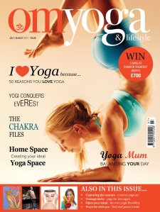 Angela Angela Kukhahn in Forearm Balance on the cover of OM Yoga Magazine July/August 2011