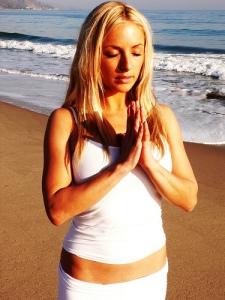 Angela Kukhahn doing yoga on the beach photo by Leelu morris