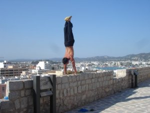 brian aganad doing yoga in ibiza, spain handstanding