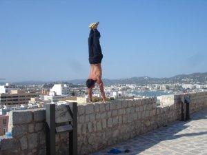 brian aganad doing yoga in ibiza, spain handstanding