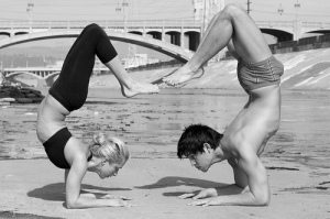 Angela Kukhahn AND Brian Aganad in forearm scorpion pose