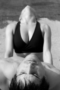 Angela Kukhahn and Brian Aganad doing yoga photo by Tara Rice