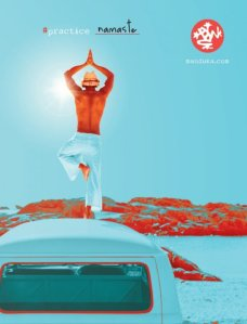 Man in tree pose on top of car for manduka yoga mats