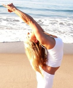 Angela Kukhahn on Santa Monica Beach doing yoga Photo by Leelu Morris