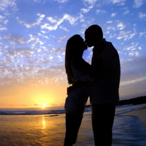 couple kissing on beach love