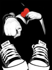 lover black and white holding a red heart