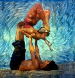 Mackenzie Miller and Andrew Abaria in a piece of artwork by master artist Robert Sturman doing yoga on the beach