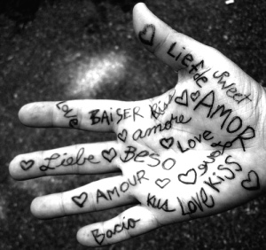 Love written on hand in many languages