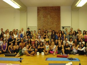 Operation Shanti Yoga Fundraiser. Photo of students taking Yoga Earth shot