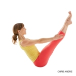 Yoga girl in Navasana (boat pose)