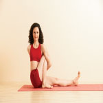 Yoga Woman doing Marichyasana C