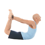 Yogi doing yoga Bow Pose Dhanurasana