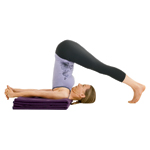 Yogi in Halasana Plow Pose
