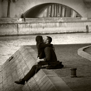 Lovers kissing by the river